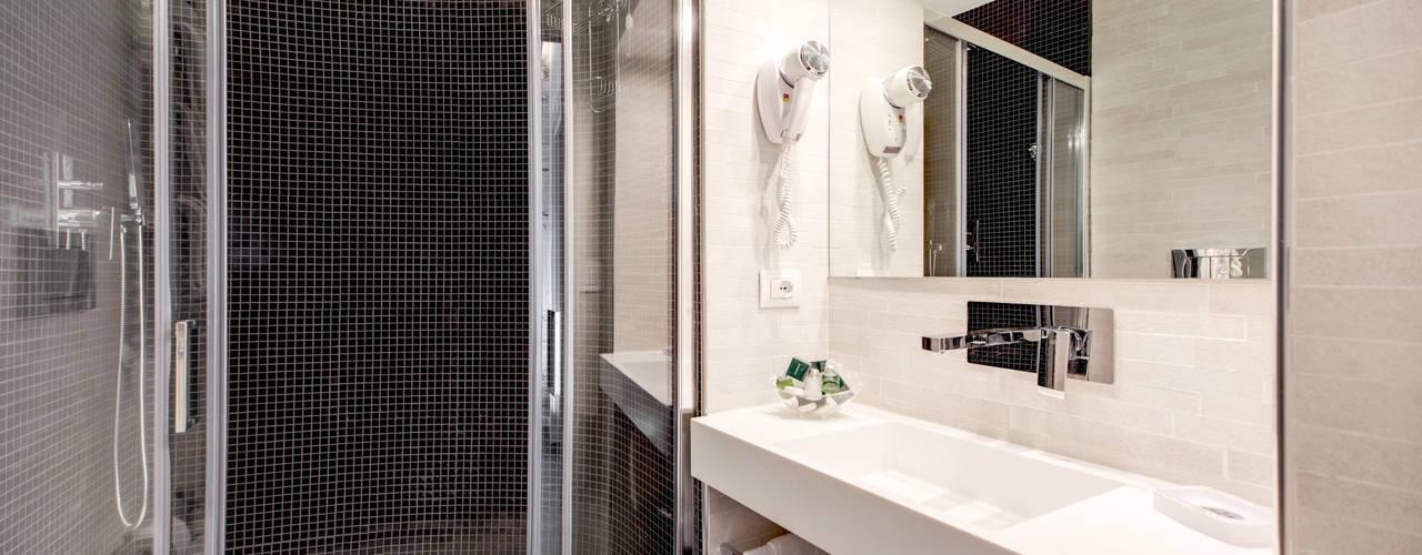 Casas de banho modernas por Arch. Lamberto Grutter Moderno