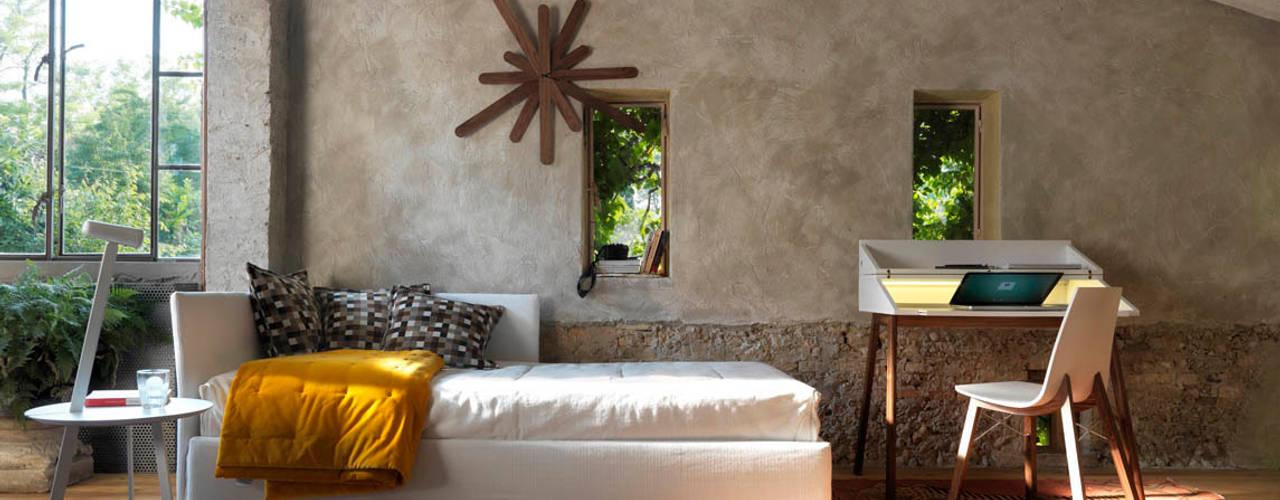 El dormitorio en la casa rural HORM.IT Dormitorios de estilo rural