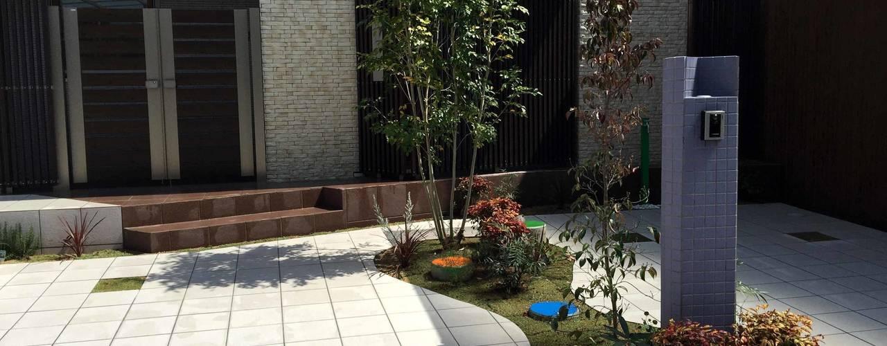 見えない深慮 単一素材で作り上げたエクステリア sotoDesign 株式会社竹本造園 モダンな 家
