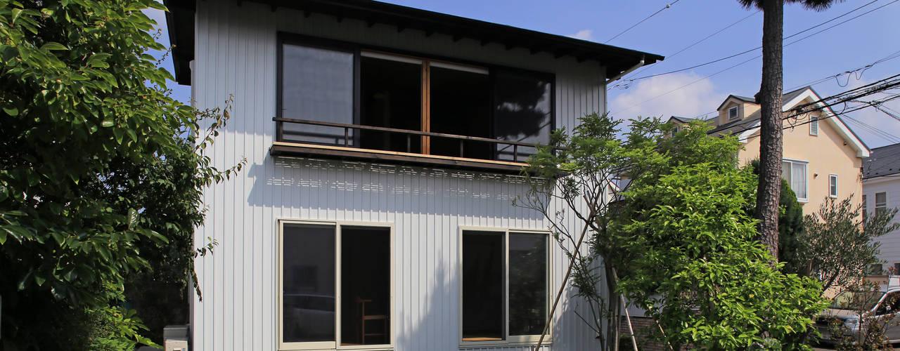 Maisons originales par 早田雄次郎建築設計事務所/Yujiro Hayata Architect & Associates Éclectique