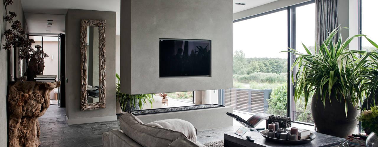 Salas de estilo  por Studiozwart Architecten BNA