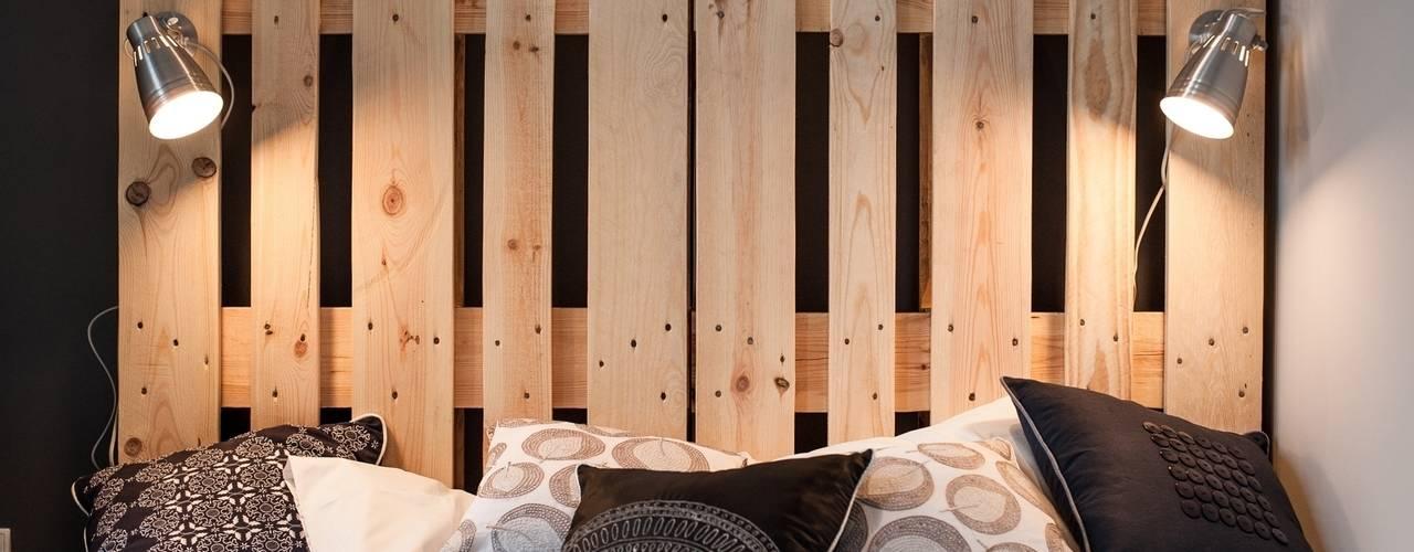 Dormitorios de estilo  por Raca Architekci