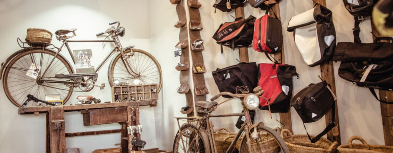 Decoración Vintage tienda de bicis. Oficinas y tiendas de estilo ecléctico de Ideas Interiorismo Exclusivo, SLU Ecléctico