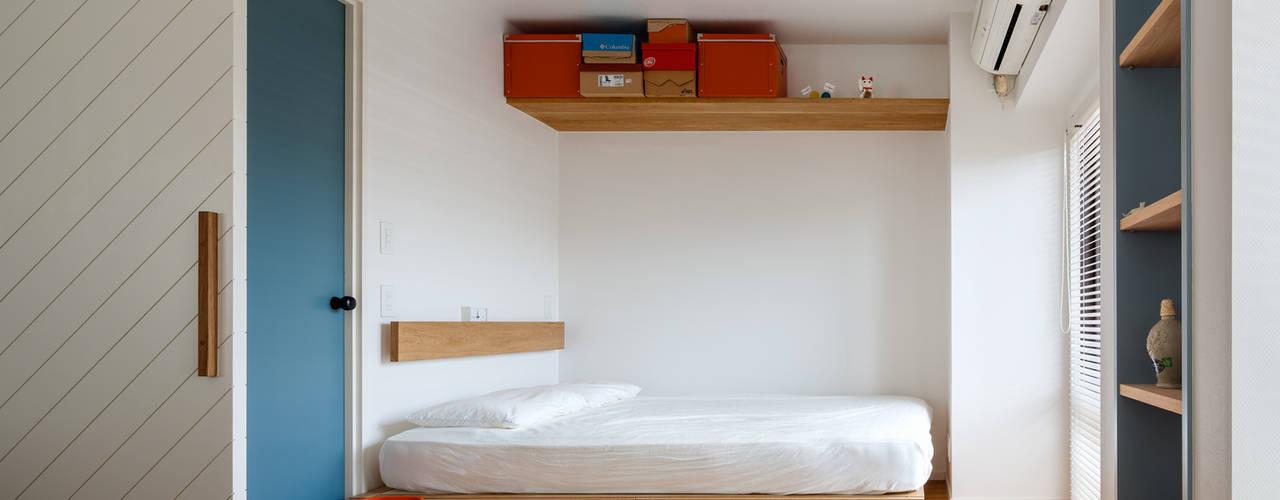 A residence in Shibuya Dormitorios eclécticos de sorama me Inc. Ecléctico