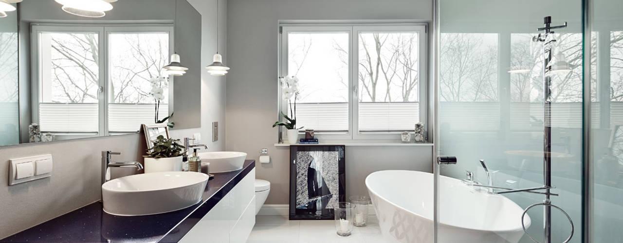 Baños de estilo  por AvoCADo