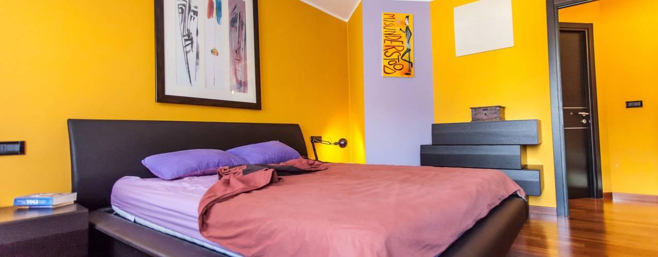 Dormitorios de estilo  por UAU un'architettura unica, Moderno