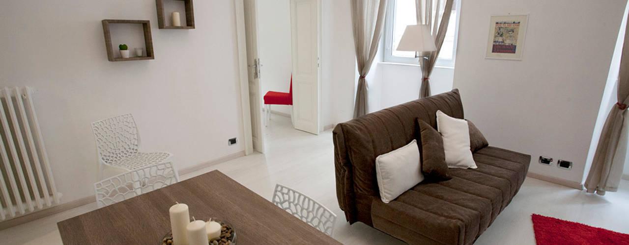 Salas de estilo  por Pamela Tranquilli Interior Designer , Ecléctico