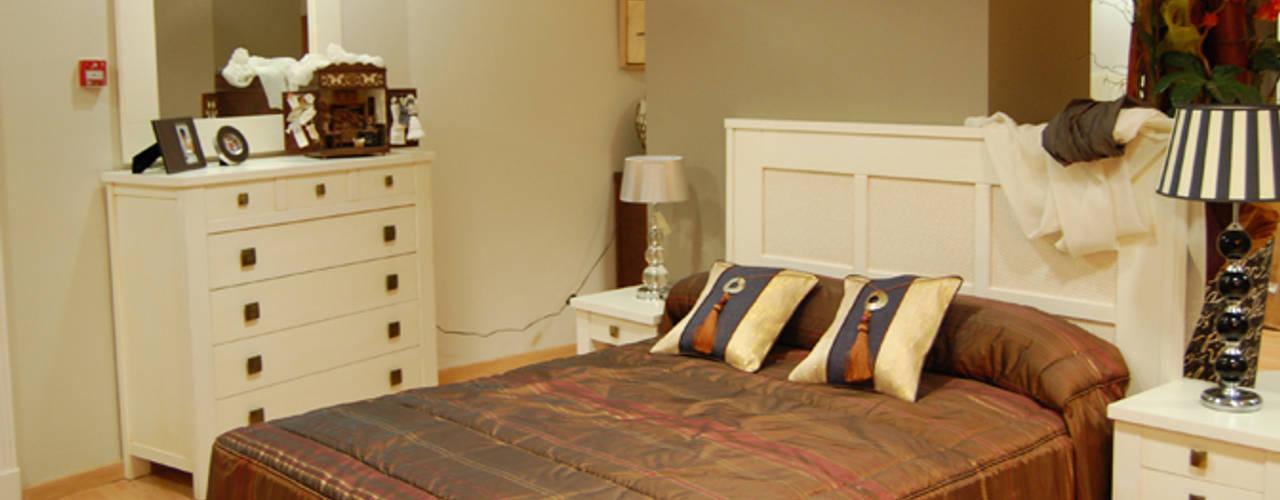 Nuestro showroom:  de estilo  de Gramil Interiorismo II - Decoradores y diseñadores de interiores ,