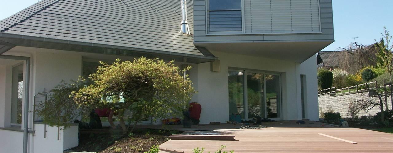Casas minimalistas por gmyrekarchitekten Minimalista
