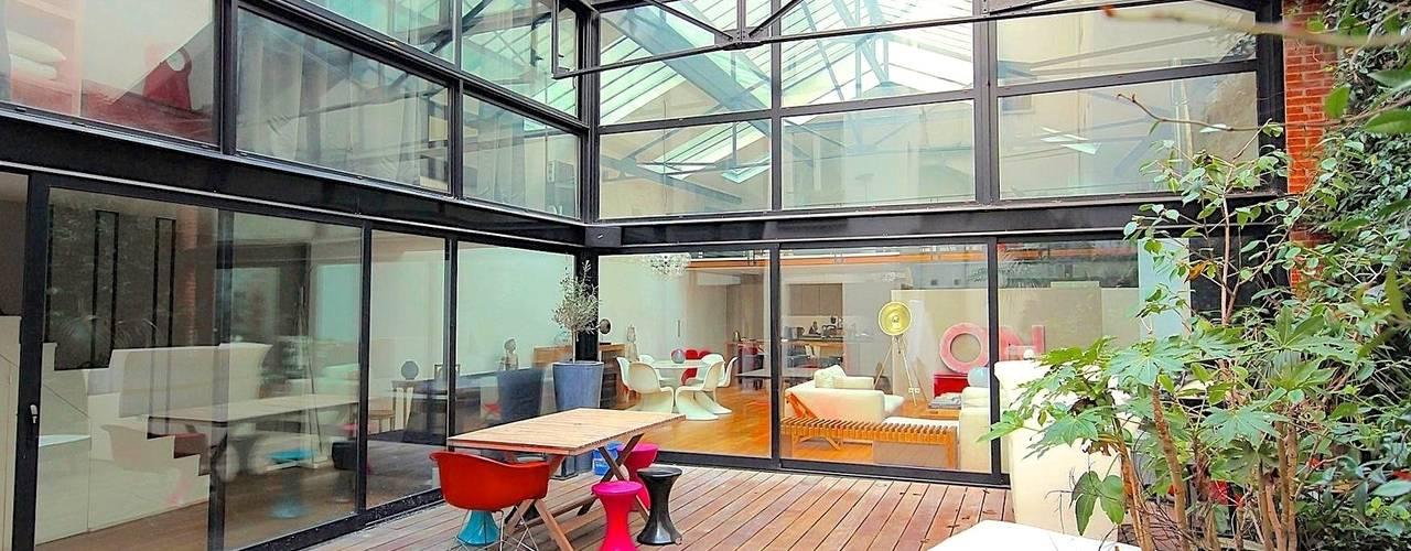 Transformation ferronnerie en Loft/maison de ville: Terrasse de style  par Selig&Renault
