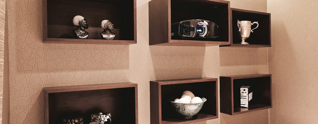 Wall mounted cabinet hosting HD projector and accessories: modern Media room by Finite Solutions