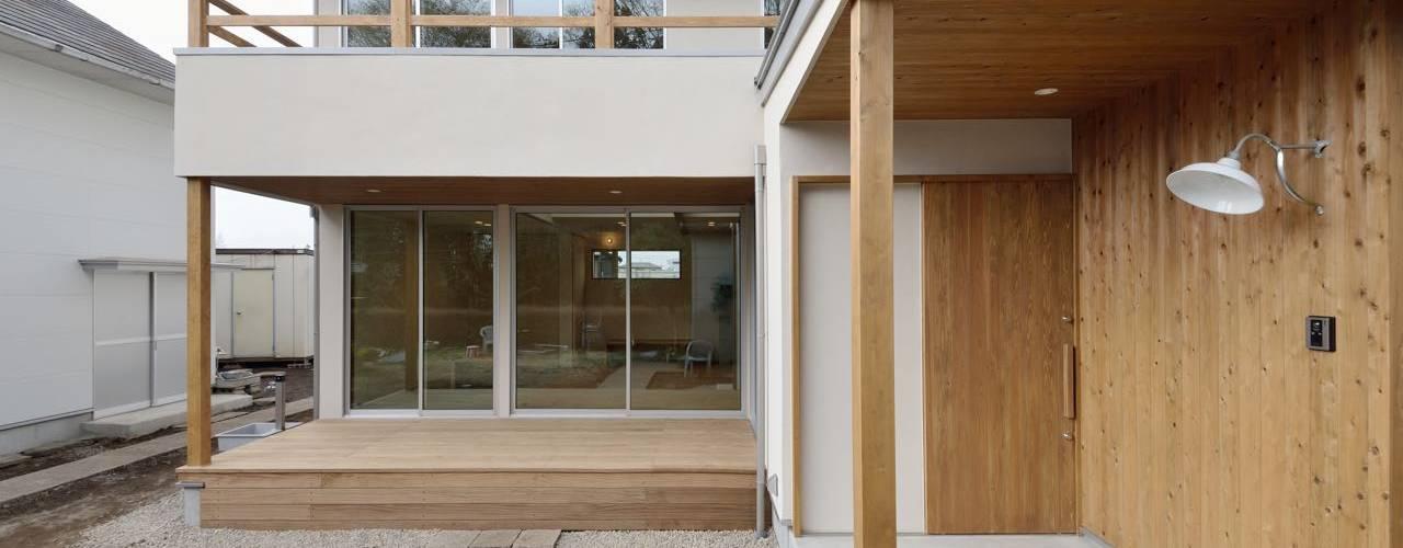 ボルダリング壁のある家: アトリエdoor一級建築士事務所が手掛けた家です。,モダン