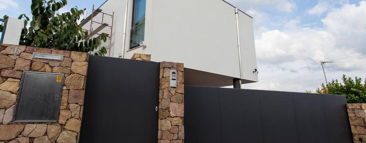 Casas de estilo  por AreA7, Moderno
