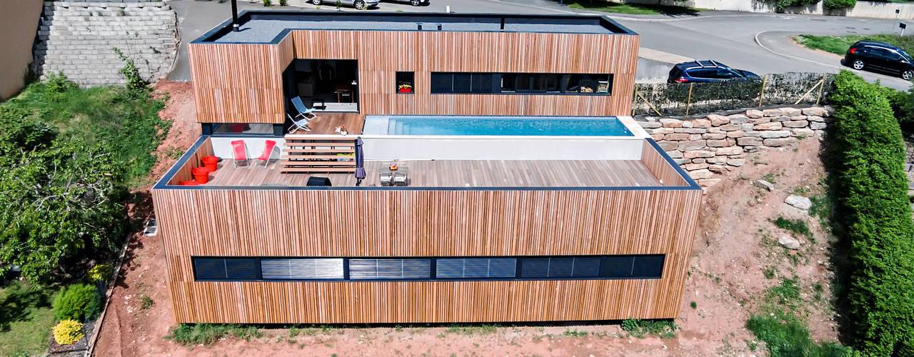 Casas  por Hugues TOURNIER Architecte , Minimalista