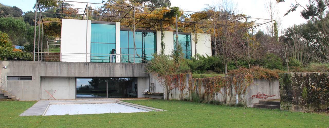 Casas de estilo  por A. BURMESTER ARQUITECTOS, Moderno