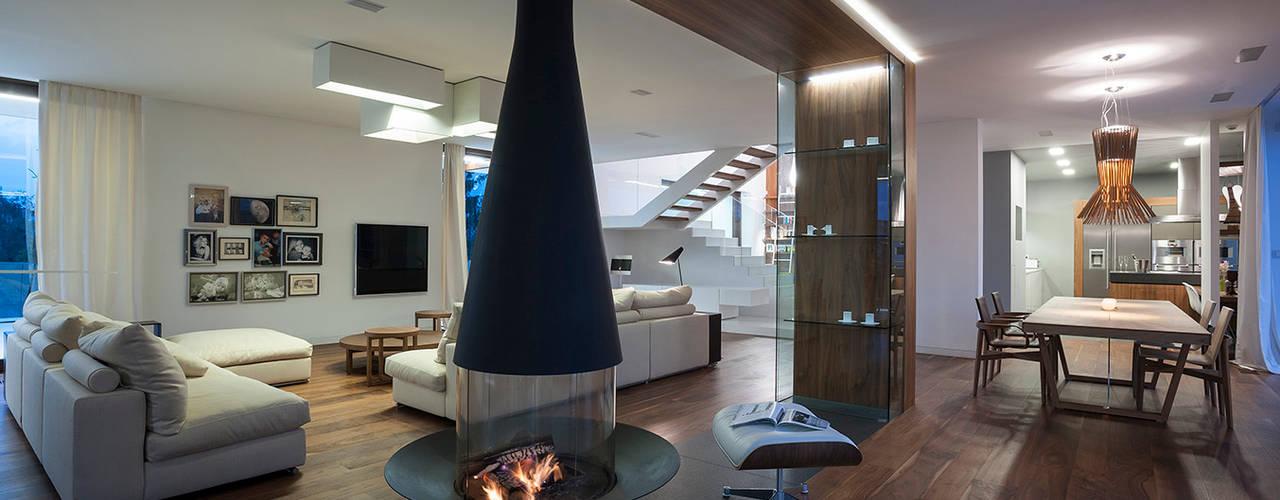 EDGE HOUSE: styl , w kategorii Salon zaprojektowany przez MOBIUS ARCHITEKCI PRZEMEK OLCZYK,Nowoczesny