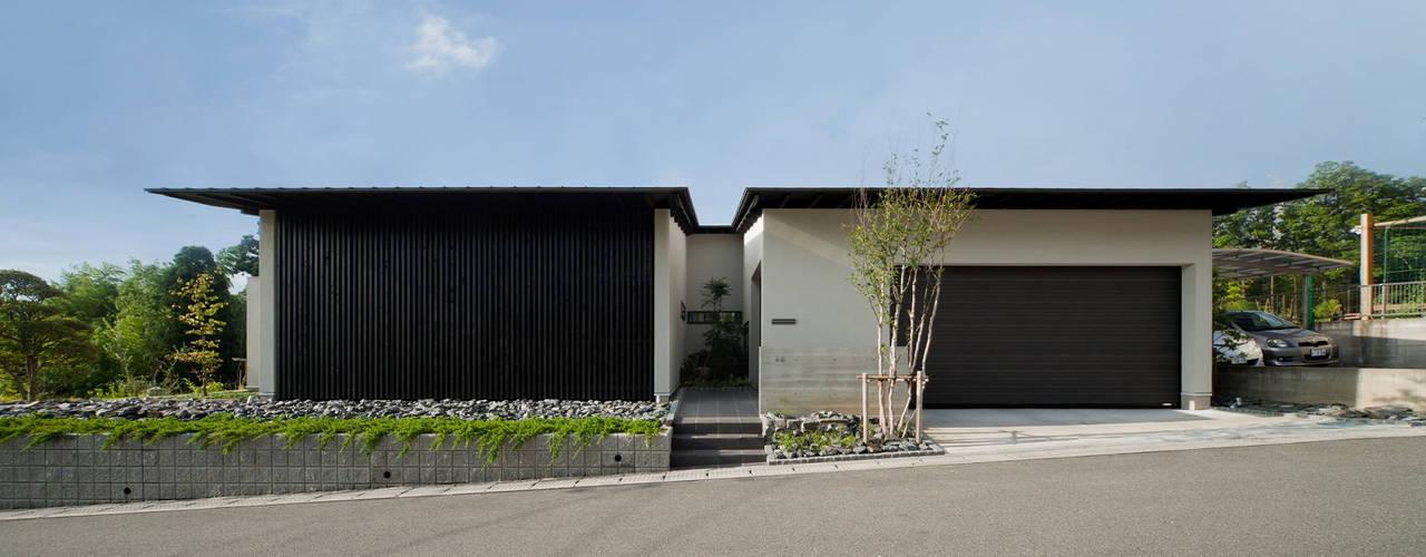 終の棲家: Egawa Architectural Studioが手掛けた家です。,カントリー