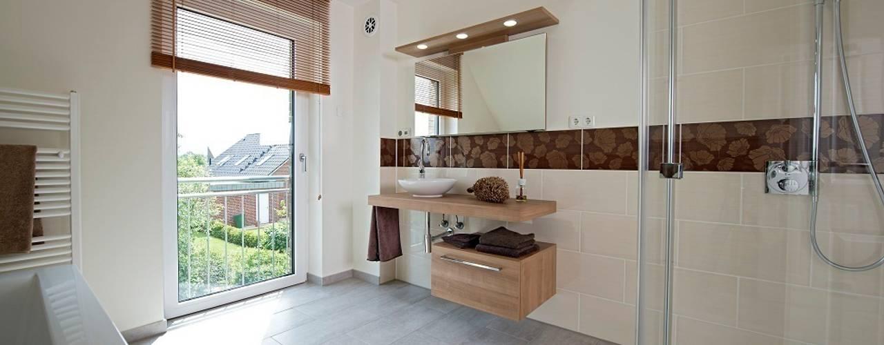 Ванные комнаты в . Автор – Heinz von Heiden GmbH Massivhäuser