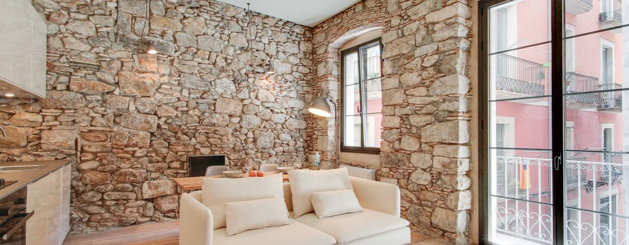 Salas / recibidores de estilo  por Lara Pujol  |  Interiorismo & Proyectos de diseño
