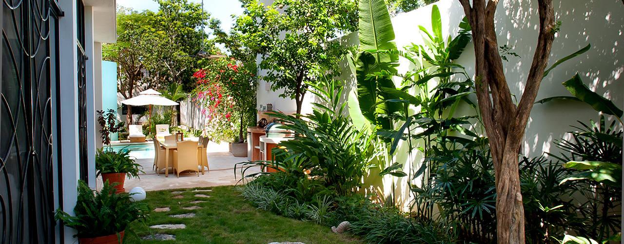 Casa CP78: Jardines de estilo  por Taller Estilo Arquitectura