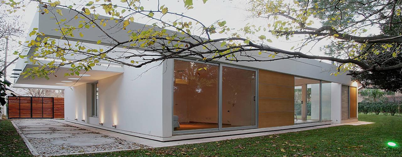 Дома в стиле модерн от METODO33 Модерн