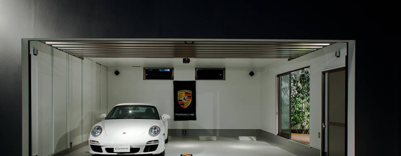 Garage Y: 堺武治建築事務所が手掛けたガレージです。,モダン