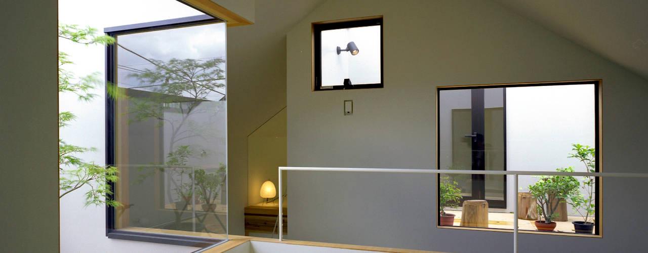 習志野台の家: シミズアトリエ 一級建築士事務所が手掛けた和室です。,ミニマル