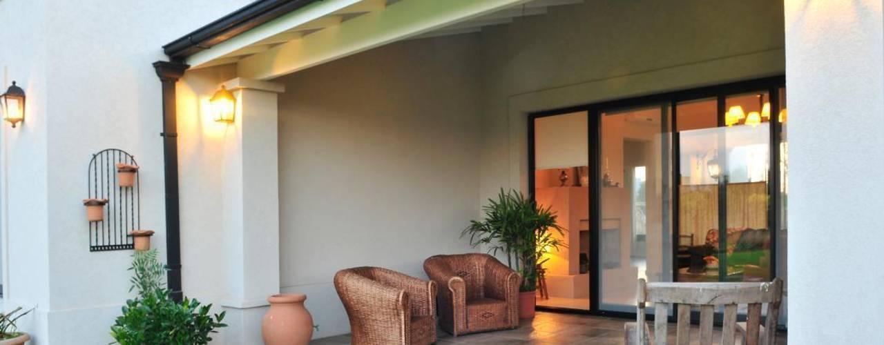 Casas de estilo  por Parrado Arquitectura, Rural