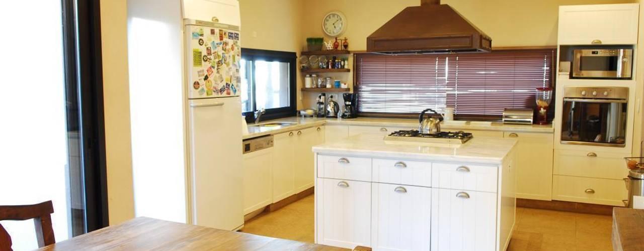 Cocinas de estilo  por Parrado Arquitectura