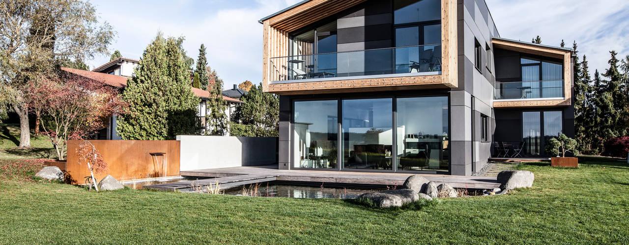 Casas de estilo ecléctico de 21-arch GmbH Ecléctico