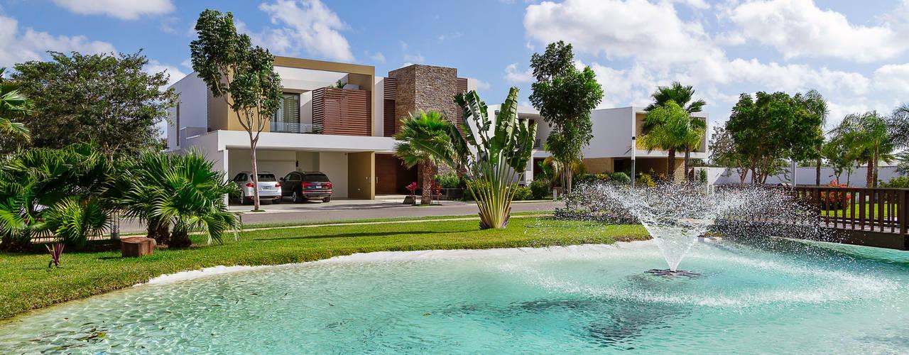 Дома в стиле модерн от Enrique Cabrera Arquitecto Модерн