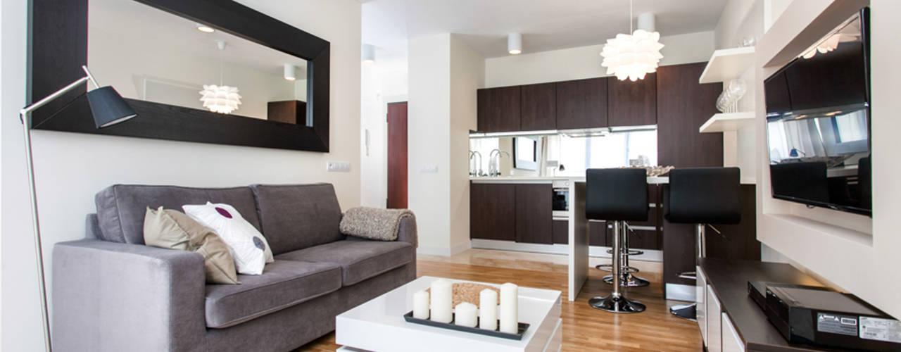 Garden Residence 11 - 32m2: styl , w kategorii Salon zaprojektowany przez UNQO