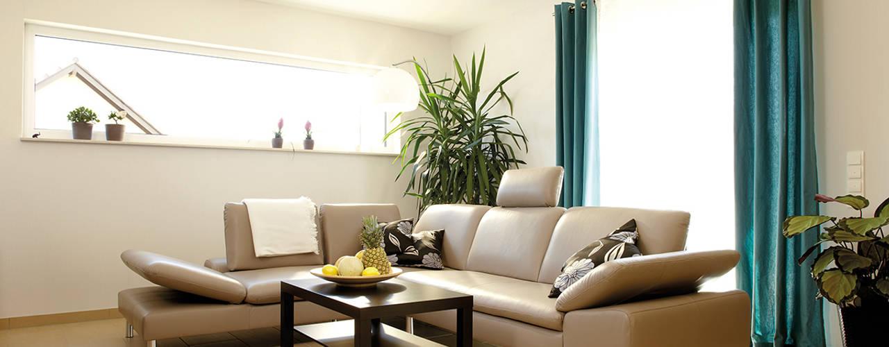 Living room by FingerHaus GmbH - Bauunternehmen in Frankenberg (Eder)