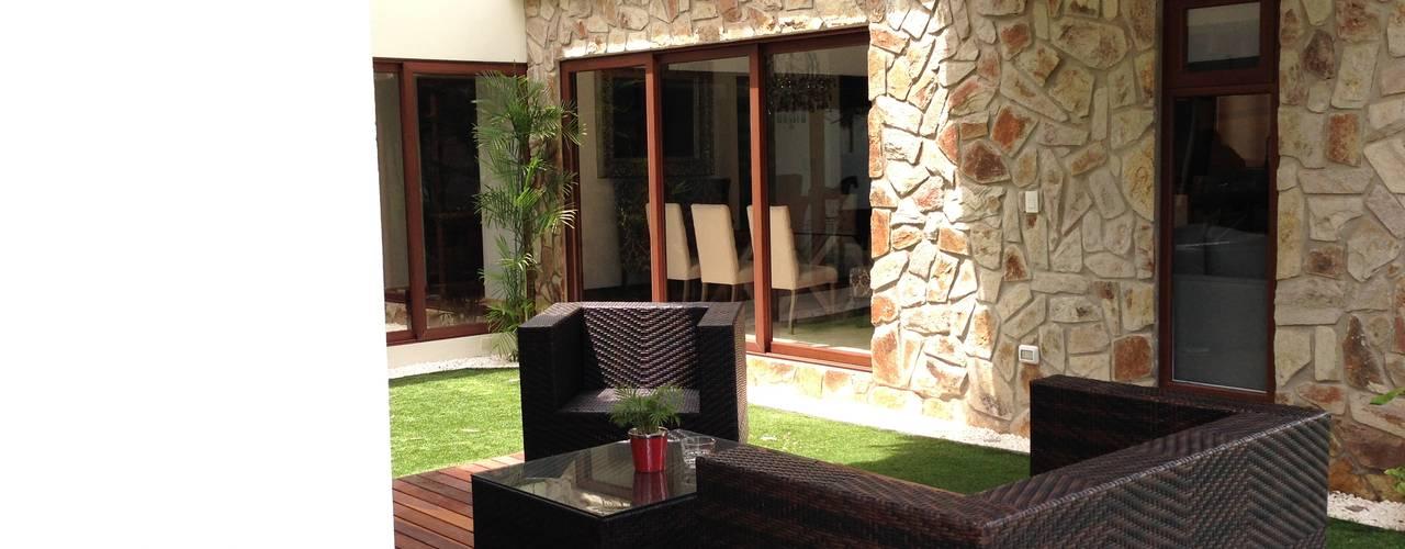 casa 240: Terrazas de estilo  por Hussein Garzon arquitectura