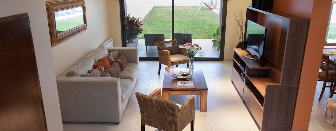 Salas de estar  por Estudio Alvarez Angiono