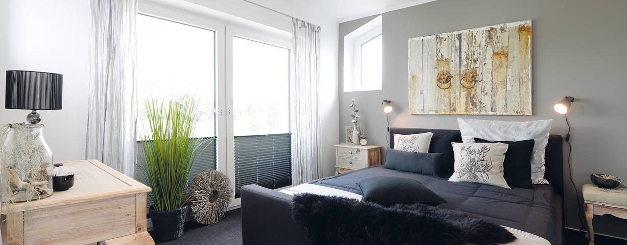Camera da letto moderna di Danhaus GmbH Moderno