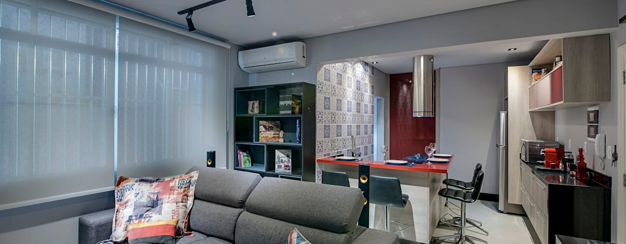 Lofts nova-iorquinos inspiram projeto de apartamento no litoral paulista Salas de estar modernas por Guido Iluminação e Design Moderno