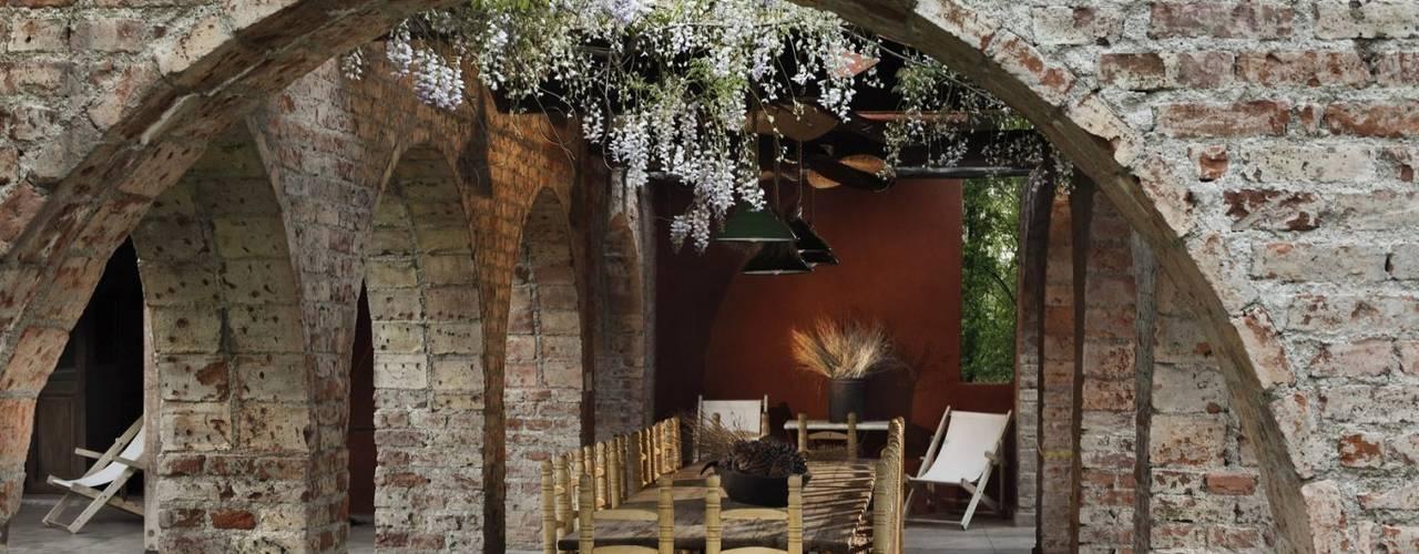 Jardines de invierno de estilo rústico de Bórmida & Yanzón arquitectos Rústico