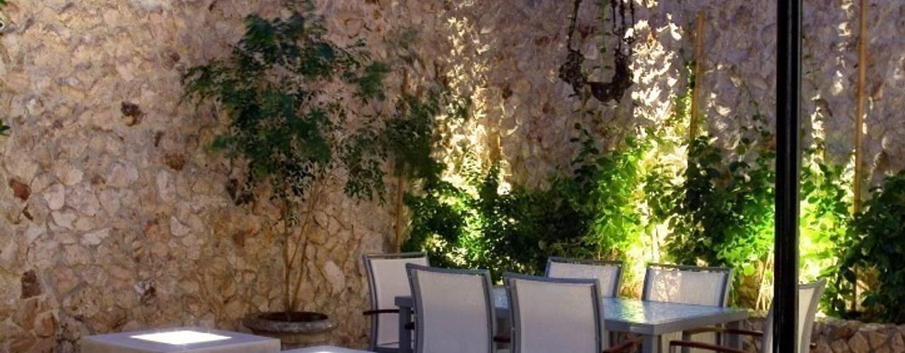 Jardines de estilo ecléctico de Taller Estilo Arquitectura Ecléctico
