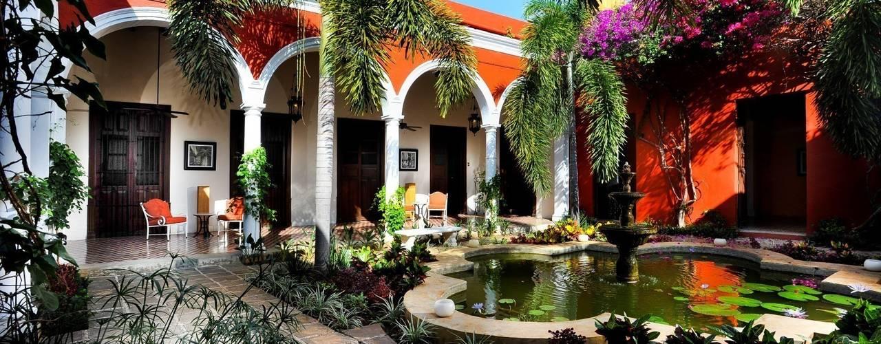 Гостиницы в эклектичном стиле от Taller Estilo Arquitectura Эклектичный