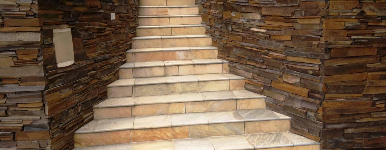 11 ideas para revestir las escaleras se ver n fabulosas for Cubrir una pared exterior