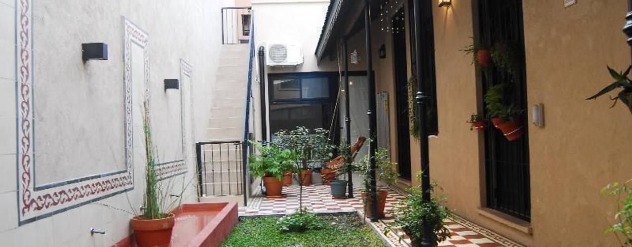 Giardino in stile in stile Eclettico di Parrado Arquitectura
