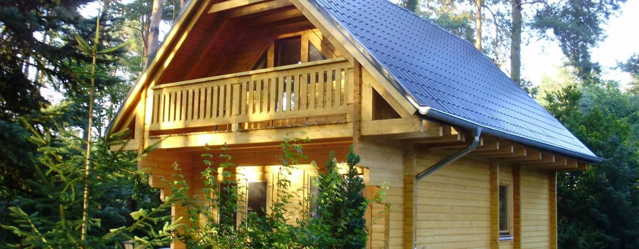 Casas rústicas por THULE Blockhaus GmbH - Ihr Fertigbausatz für ein Holzhaus Rústico