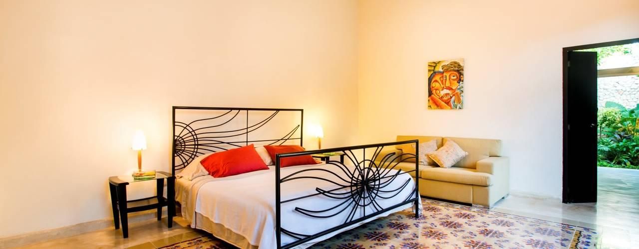 Dormitorios de estilo  de Taller Estilo Arquitectura,
