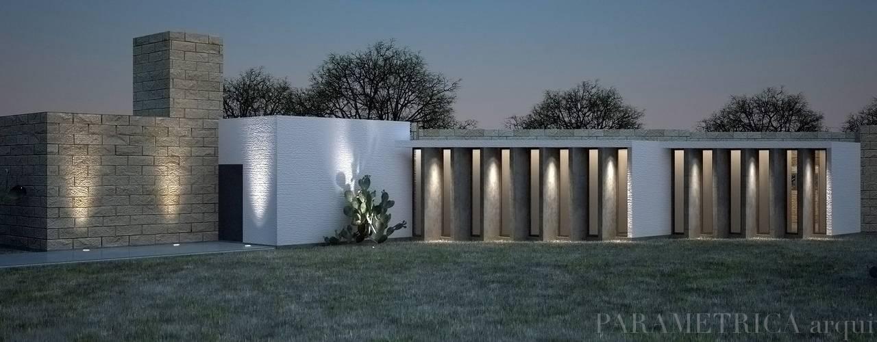 Projekty, wiejskie Domy zaprojektowane przez Paramétrica Arquitectos