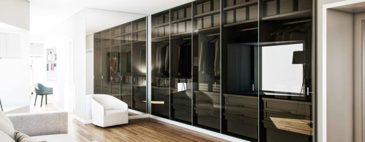 Moradia no Porto: Closets modernos por Vilaça Interiores