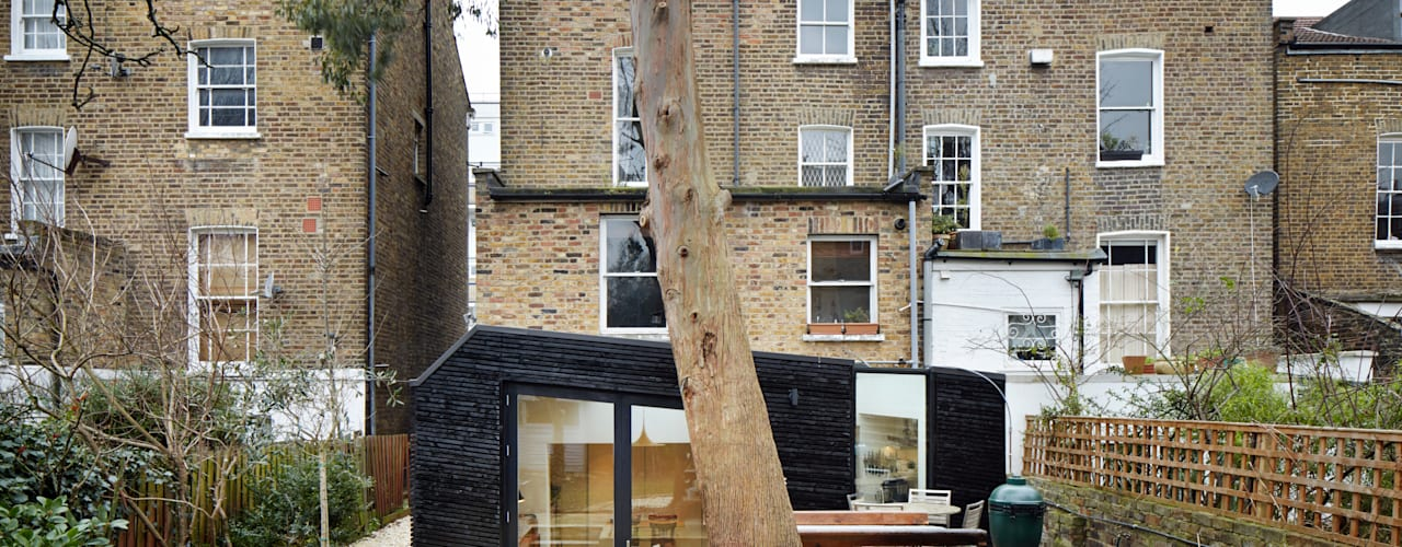 Rear elevation showing materiality :  Houses by Fraher Architects Ltd