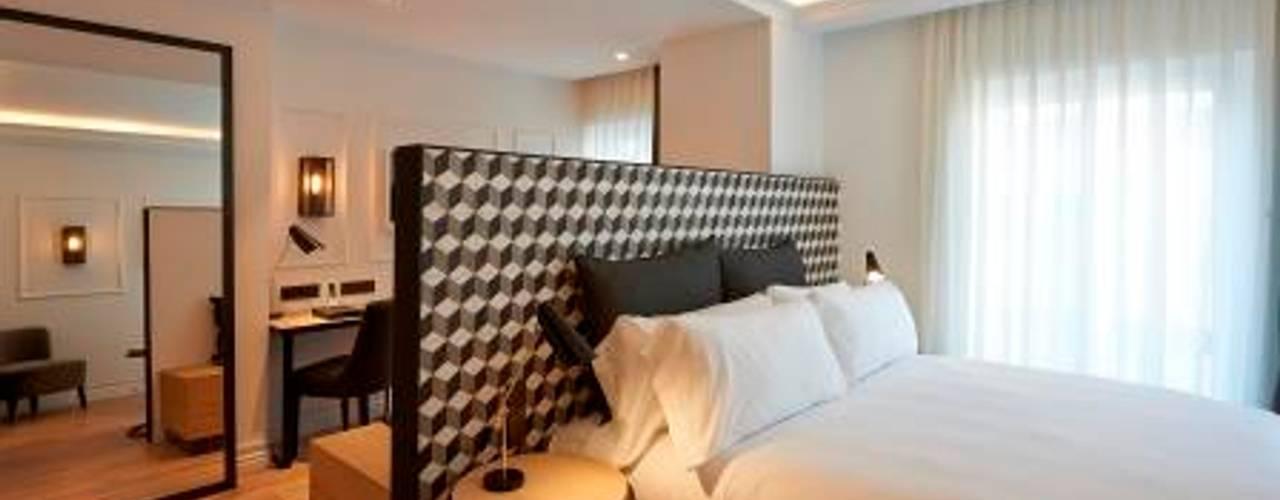 Dormitorios de estilo  por Mosaics Torra