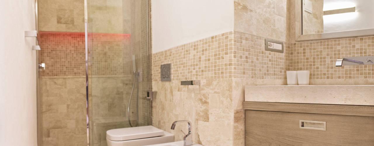 Baños de estilo  por Architetti Porto Cervo,