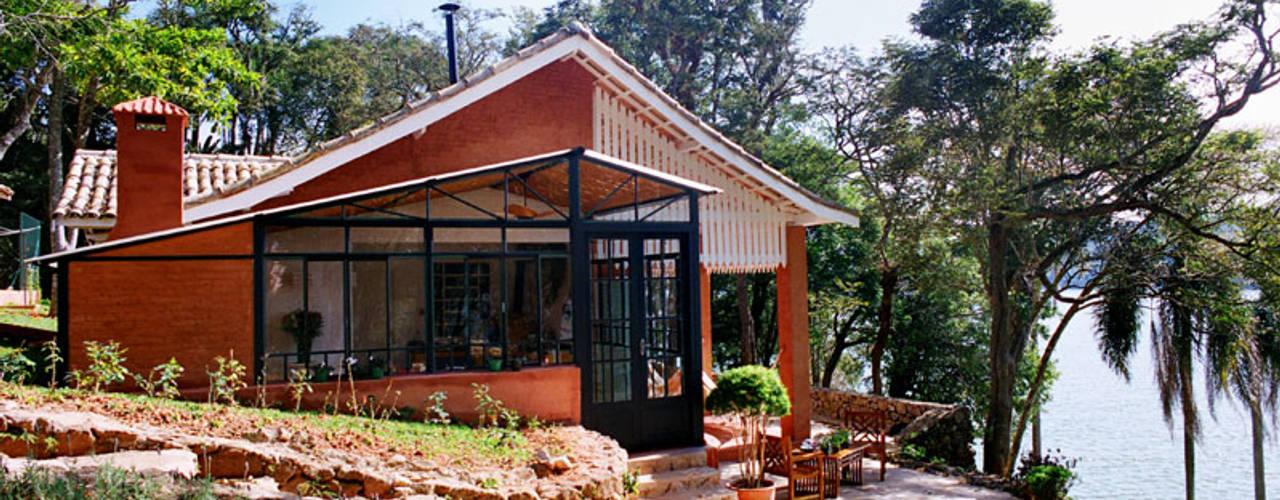 Casas de estilo rural de Célia Orlandi por Ato em Arte Rural
